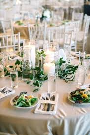 candles greenery centerpiece simple wedding centerpieces silver