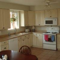 Ivory Colored Kitchen Cabinets - l shape kitchen decoration using round recessed light in kitchen