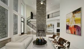 Stone Wall Living Room by Modern White Living Room With Cowhide Couch Featuring A Dry Stack