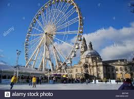 winter wonderland ice skating rink with big wheel city hall