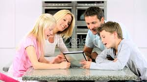 young family with wireless tablet in kitchen royalty free video