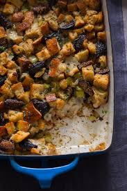 bread dressing recipes for thanksgiving fig herb and sausage stuffing spoon fork bacon