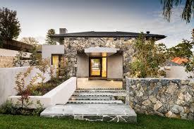 modern home design with stone facade ambientes residenciais