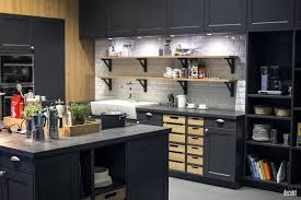 gray kitchen island with wood countertop double wall ovens wooden