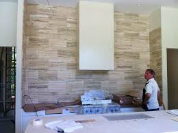 12x24 natural stone tile at kitchen backsplash countertop up to