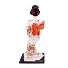 japanese geisha in white kimono with brown fan figurines