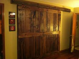 Reclaimed Wood Interior Doors Reclaimed Wood Sliding Barn Doors With Big Metal Rod Hanging On