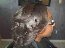 pictures of a black blowout hairstyle difference between a wash and set and a blowout photos
