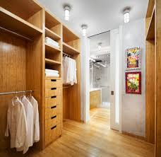 Walk In Closet Shelving by Amazing Walk In Closet With Wardrobes Wood Shelves