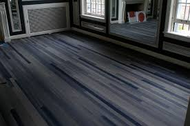 sliding glass interior doors with reclaimed dark wood floor also