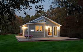 Prefab House by Charming Prefab House Design Idea With Gray Wall White Lamps In
