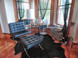 Black Cowhide Rugs Endearing Natural Living Room Design Featuring Single Sofa With
