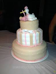 babyshower cake for with 3 layers and a stork carrying baby
