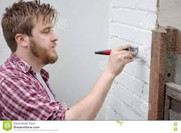 man painting house wall with brush diy home improvement stock