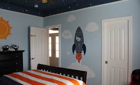 Kids Space Room by Comfortable Arm Chair On Wooden Flooring Decorated With Space