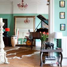the piano the rug mirror guitar bongo colors books spaces
