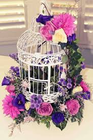cool ornamental bird cages wedding centerpieces with flowers