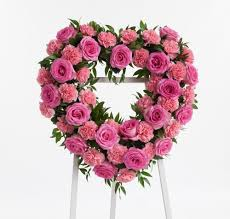pink rose and carnation casket spray stadium flowers