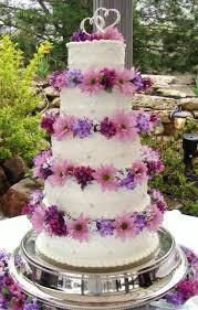 five tier round white wedding cake with silver heart toppers and