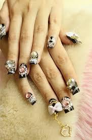 japanese nail art black nails with lots of deco hearts bows