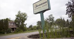funeral home shut down amid reports of maggots decomposing bodies
