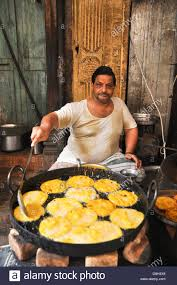 jodhpur cuisine frying food in his food stall jodhpur rajasthan india stock
