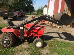 my new gravely 1970 l8 super governer with estate sulky