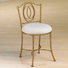 elegant backless vanity chair with ornate gilded wrought iron
