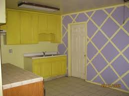 modern home mix purple color and yellow color for wall painting