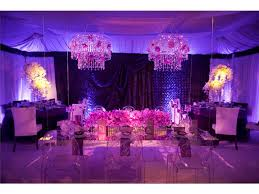 Lighting And Chandeliers Up Wedding Reception Room With Purple Lighting And Orchids Ghost