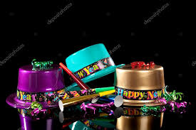 new years noisemakers new years hat and noisemakers on black stock photo
