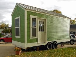 nice green tiny house on wheels for sale be on the side of the
