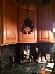 how to hang a wreath on a kitchen cabinet snapguide