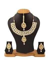 gold stone necklace sets images Golden studded kundan stone necklace set with maang tika at rs jpg