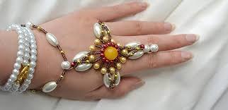 pearls bracelet diy images Pandahall tutorial on how to make a handmade cross pearl bracelet jpg