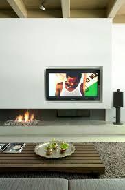 cheminee moderne design télé montée au dessus de la cheminée une mode récente
