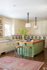 green kitchen cabinets with white island painted kitchen cabinet ideas architectural digest
