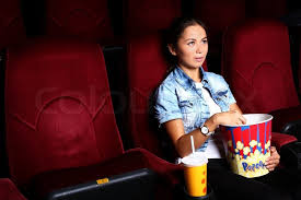 one young watching movie in cinema stock photo colourbox