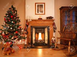 traditional living room with a cosy open fire adorned with