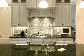 granite countertop galley white cabinets tile murals tile art
