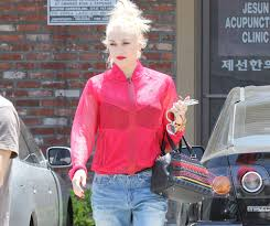 gwen stefani carries christian louboutin spikes to the