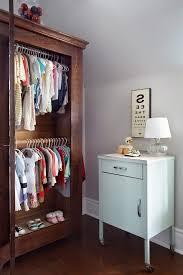 toronto coat closet armoire nursery contemporary with baby clothes