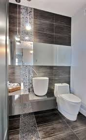Modern Tile Bathroom - the neutral colours and minimalist styling used in this bathroom