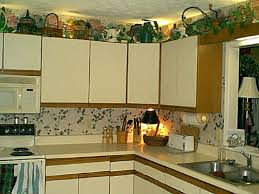 Above Kitchen Cabinet Decor Ideas by Kitchens Decorating Ideas