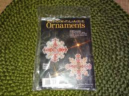two sets of unopened snowflake ornament kits christmas ornament