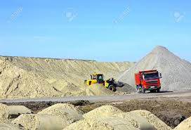dump truck and bulldozer working on road construction stock photo