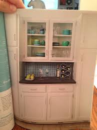 great bar area for kitchen wall between pantry storage underneath