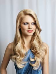 long blonde with big loose curls and a side part hairstyle hair