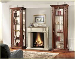 classy wooden cabinet with glass doors displaying items in