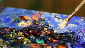 artist brush mix color oil painting on palette is holding in his